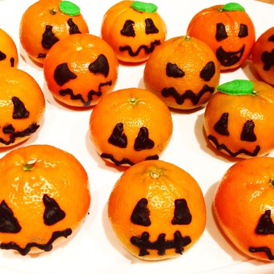 "<img src=""clementine-jack-o-lanterns.jpg"" alt=""Clementine Jack O Lanterns"" />"